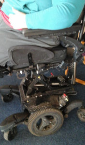 My quickie jive powerchair. The focus is on the workings (and it's in the up position) and all you can see of me is my arm/leg